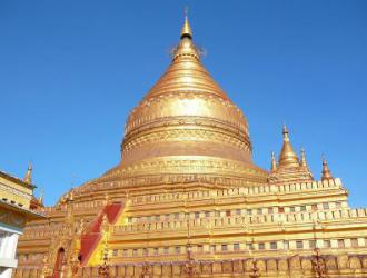 The golden building is the Shwe Zigon Pagoda, Bagan.